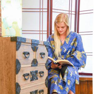 Pretty woman reading while wearing a kimono
